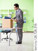 Купить «Male employee collecting his stuff after redundancy», фото № 28728316, снято 14 мая 2018 г. (c) Elnur / Фотобанк Лори