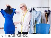 Купить «Woman tailor working on new dress designs», фото № 28728632, снято 13 апреля 2018 г. (c) Elnur / Фотобанк Лори
