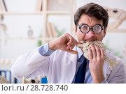 Купить «Funny crazy professor studying animal skeletons», фото № 28728740, снято 7 марта 2018 г. (c) Elnur / Фотобанк Лори