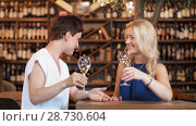 Купить «happy women drinking wine at bar or restaurant», видеоролик № 28730604, снято 4 июля 2018 г. (c) Syda Productions / Фотобанк Лори