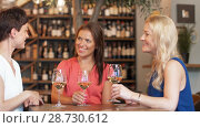 Купить «happy women drinking wine at bar or restaurant», видеоролик № 28730612, снято 4 июля 2018 г. (c) Syda Productions / Фотобанк Лори