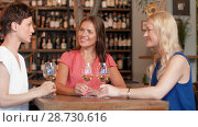 Купить «happy women drinking wine at bar or restaurant», видеоролик № 28730616, снято 4 июля 2018 г. (c) Syda Productions / Фотобанк Лори
