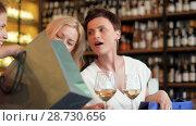 Купить «women with shopping bags at wine bar or restaurant», видеоролик № 28730656, снято 4 июля 2018 г. (c) Syda Productions / Фотобанк Лори
