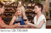 Купить «happy women drinking red wine at bar or restaurant», видеоролик № 28730664, снято 4 июля 2018 г. (c) Syda Productions / Фотобанк Лори