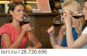 Купить «happy women drinking red wine at bar or restaurant», видеоролик № 28730696, снято 4 июля 2018 г. (c) Syda Productions / Фотобанк Лори