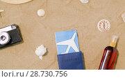 Купить «travel tickets, camera and hat on beach sand», видеоролик № 28730756, снято 5 июля 2018 г. (c) Syda Productions / Фотобанк Лори