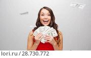 Купить «happy woman in red dress with us dollar money», видеоролик № 28730772, снято 9 июля 2018 г. (c) Syda Productions / Фотобанк Лори
