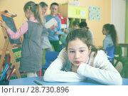 Купить «Upset girl in schoolroom during break», фото № 28730896, снято 28 января 2018 г. (c) Яков Филимонов / Фотобанк Лори