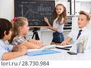 Купить «Girl discussing about mathematical formulas», фото № 28730984, снято 12 октября 2017 г. (c) Яков Филимонов / Фотобанк Лори