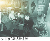 Купить «five children playing in bunker quest room», фото № 28730996, снято 21 октября 2017 г. (c) Яков Филимонов / Фотобанк Лори