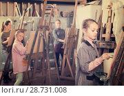 Купить «schoolgirls diligently training their painting skills during class at art studio», фото № 28731008, снято 3 июня 2020 г. (c) Яков Филимонов / Фотобанк Лори