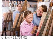 Купить «Female teacher helping girl during painting class», фото № 28731024, снято 22 октября 2018 г. (c) Яков Филимонов / Фотобанк Лори