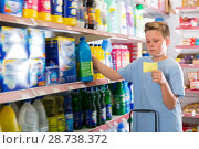 Купить «Focused positive boy looking at shopping list», фото № 28738372, снято 4 июня 2018 г. (c) Яков Филимонов / Фотобанк Лори