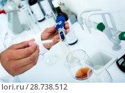 Купить «Wine being checked on component saturation in laboratory», фото № 28738512, снято 16 июля 2018 г. (c) Яков Филимонов / Фотобанк Лори