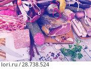 Купить «Variety of meats on table», фото № 28738524, снято 18 октября 2018 г. (c) Яков Филимонов / Фотобанк Лори