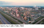 Купить «Oil refinery plant industry, Refinery factory, oil storage tank and pipeline steel with sunrise and cloudy sky background, Russia», видеоролик № 28738780, снято 10 июля 2018 г. (c) Mikhail Starodubov / Фотобанк Лори