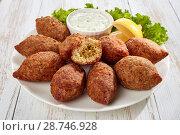 Купить «kibbeh stuffed with fried beef ragout», фото № 28746928, снято 2 июля 2018 г. (c) Oksana Zh / Фотобанк Лори