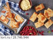 Купить «freshly baked portions of puff pastry», фото № 28746944, снято 4 июля 2018 г. (c) Oksana Zh / Фотобанк Лори