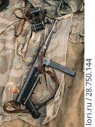 Купить «German Military Ammunition - Grenade, Binoculars And Sub-machine Gun Mp 40 Of World War II On Ground.», фото № 28750144, снято 2 октября 2016 г. (c) easy Fotostock / Фотобанк Лори