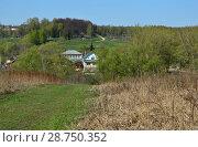 Купить «Частные деревянные одно-двухэтажные дома в городе Волоколамске. Московская область», эксклюзивное фото № 28750352, снято 6 мая 2015 г. (c) lana1501 / Фотобанк Лори