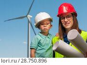 Купить «Concept of engineers and windmills», фото № 28750896, снято 16 июня 2018 г. (c) Pavel Biryukov / Фотобанк Лори