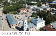 Купить «Aerial view of central Cathedral Square in Russian town of Kasimov with Ascension Cathedral and Church of Assumption», видеоролик № 28751192, снято 28 июня 2018 г. (c) Яков Филимонов / Фотобанк Лори