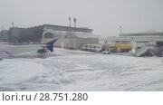 Купить «Aerodrome of Astana International Airport was covered with snow stock footage video», видеоролик № 28751280, снято 30 марта 2018 г. (c) Юлия Машкова / Фотобанк Лори