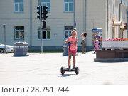 Купить «Tyumen, Russia, on July 15, 2018: the Russian girl rides a giroskuter in the summer on the square», фото № 28751744, снято 15 июля 2018 г. (c) Землянникова Вероника / Фотобанк Лори