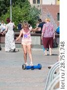 Купить «Tyumen, Russia, on July 15, 2018: the Russian girl rides a giroskuter in the summer on the square», фото № 28751748, снято 15 июля 2018 г. (c) Землянникова Вероника / Фотобанк Лори