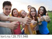 Купить «Group of young people on the field», фото № 28751948, снято 6 мая 2018 г. (c) Типляшина Евгения / Фотобанк Лори