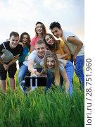 Купить «group of joyful youth on the field», фото № 28751960, снято 6 мая 2018 г. (c) Типляшина Евгения / Фотобанк Лори