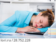 Купить «Female employee is sleeping after productive day at work», фото № 28752228, снято 9 июня 2017 г. (c) Яков Филимонов / Фотобанк Лори
