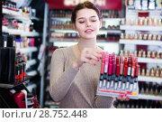Купить «glad woman customer deciding on make-up items in cosmetics shop», фото № 28752448, снято 21 февраля 2017 г. (c) Яков Филимонов / Фотобанк Лори