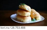 Купить «Pies with filling», видеоролик № 28753488, снято 16 июля 2018 г. (c) Peredniankina / Фотобанк Лори