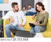 Купить «Young people with laptop and book», фото № 28753868, снято 24 мая 2018 г. (c) Яков Филимонов / Фотобанк Лори