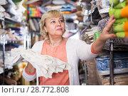 Купить «mature woman buying tablecloths», фото № 28772808, снято 29 ноября 2017 г. (c) Яков Филимонов / Фотобанк Лори