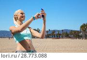 Купить «happy woman with smartphone and earphones outdoors», фото № 28773088, снято 5 июля 2015 г. (c) Syda Productions / Фотобанк Лори