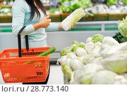 Купить «woman with basket and chinese cabbage at grocery», фото № 28773140, снято 2 ноября 2016 г. (c) Syda Productions / Фотобанк Лори