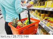 Купить «woman with food basket and jar at grocery store», фото № 28773144, снято 2 ноября 2016 г. (c) Syda Productions / Фотобанк Лори