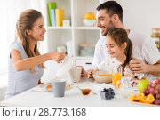 Купить «happy family having breakfast at home», фото № 28773168, снято 19 октября 2017 г. (c) Syda Productions / Фотобанк Лори