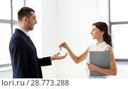 Купить «realtor giving key to customer at new office», фото № 28773288, снято 8 июня 2018 г. (c) Syda Productions / Фотобанк Лори