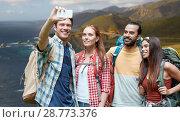 Купить «friends with backpack taking selfie by smartphone», фото № 28773376, снято 25 июля 2015 г. (c) Syda Productions / Фотобанк Лори