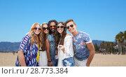Купить «hippie friends taking picture by selfie stick», фото № 28773384, снято 27 августа 2015 г. (c) Syda Productions / Фотобанк Лори
