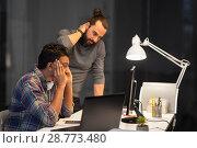 Купить «creative team with computer working late at office», фото № 28773480, снято 24 января 2018 г. (c) Syda Productions / Фотобанк Лори