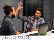 Купить «creative team making high five at night office», фото № 28773504, снято 24 января 2018 г. (c) Syda Productions / Фотобанк Лори