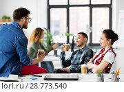 Купить «creative team drinking coffee at office», фото № 28773540, снято 1 апреля 2018 г. (c) Syda Productions / Фотобанк Лори