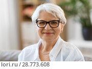 Купить «portrait of happy senior woman in glasses», фото № 28773608, снято 24 мая 2018 г. (c) Syda Productions / Фотобанк Лори