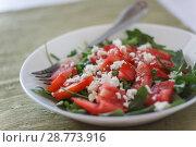 Купить «Tomato salad with basil, cheese, olive oil and garlic dressing on white background», фото № 28773916, снято 4 мая 2018 г. (c) Tetiana Chugunova / Фотобанк Лори