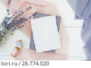 Купить «White blank card on a background of pink and blue fabric with lavender flowers on a white background. Mockup with envelope and blank card. Flat lay. Top view», фото № 28774020, снято 17 июля 2018 г. (c) Happy Letters / Фотобанк Лори