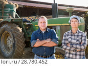 Купить «Mature spouses farmers posing near farming equipment», фото № 28780452, снято 24 октября 2017 г. (c) Яков Филимонов / Фотобанк Лори